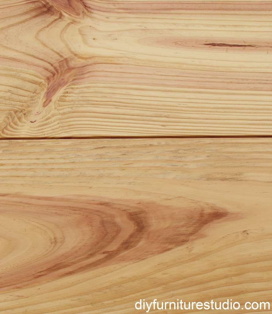 closeup of wood grain on table top of DIY rustic modern coffee table or bench with plumbing pipe legs