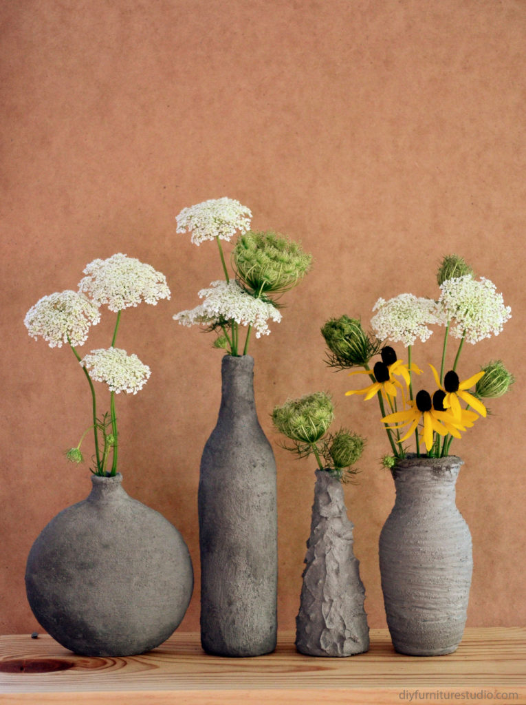 DIY concrete vases formed by hand over inexpensive glass vases