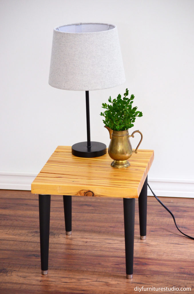 DIY side table made with an upcycled wood shim table top and modified Waddell mid-century modern tapered table legs painted black