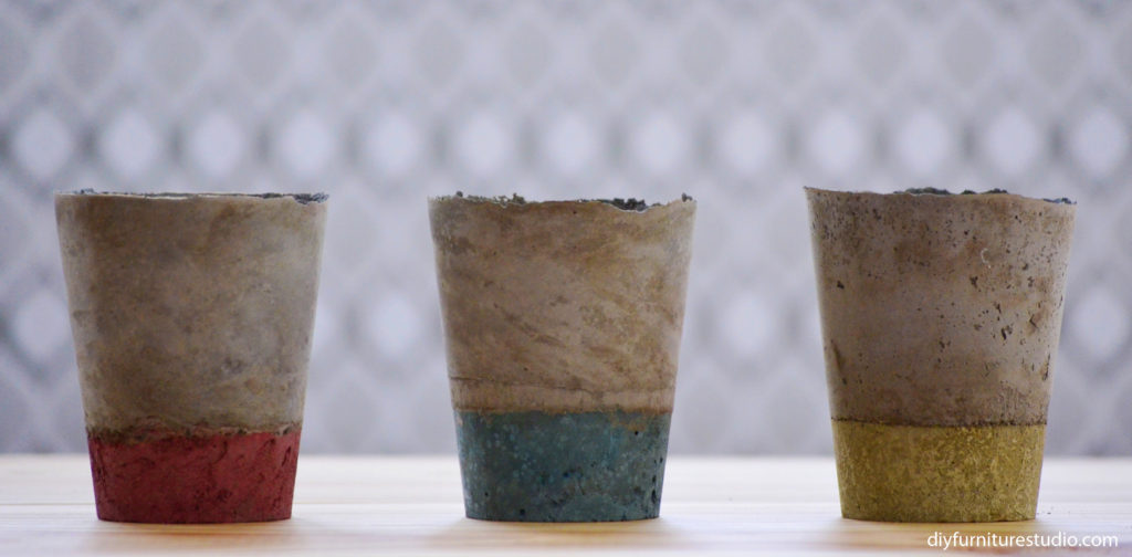 DIY cement vases colored with latex paint.