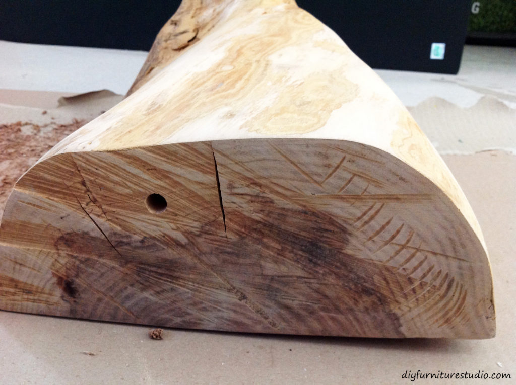Drilling hole in DIY natural wood table lamp.