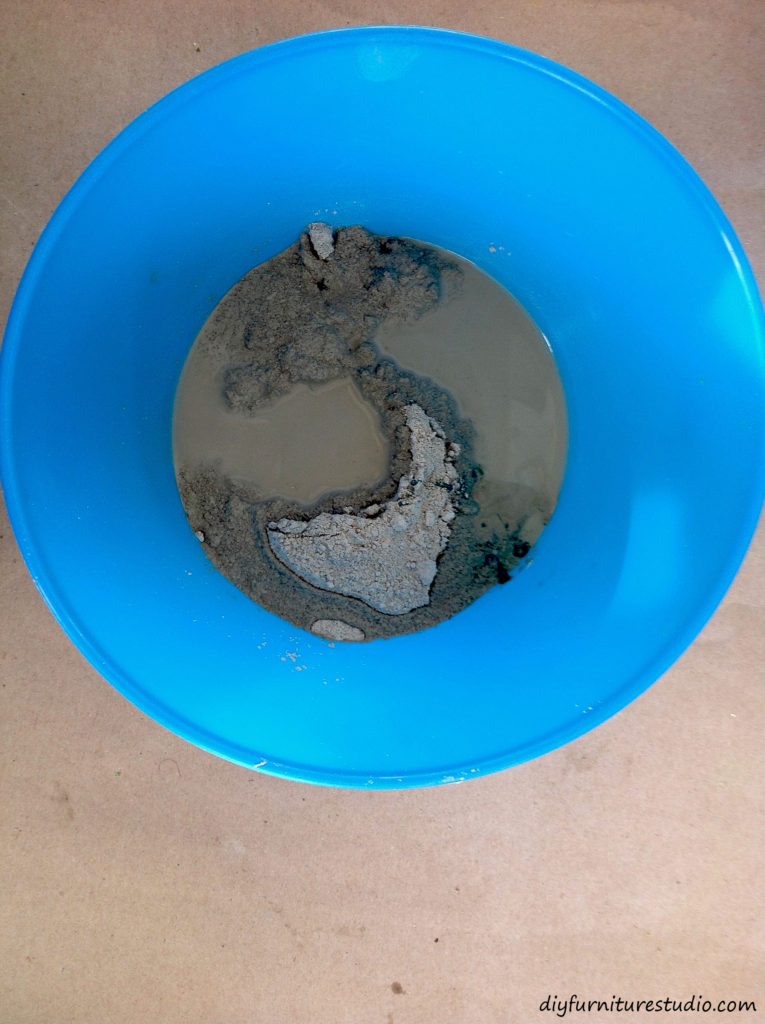Mixing a batch of cement (anchoring cement, latex paint, and water) for DIY colored decor.